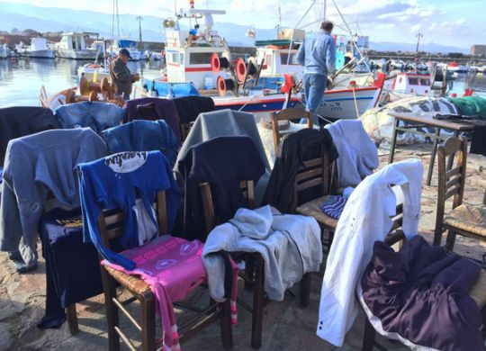 Refugee clothes draped over chairs in Molyvos, Lesvos, during the refugee crisis (For an anti-consumerism post by Ruth McAllister Kemp)